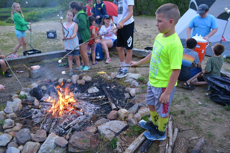 roasting marshmallows at windham tolland 4h camp